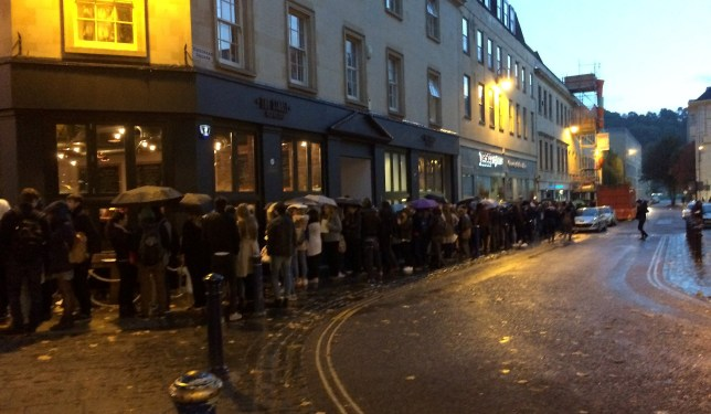 The extraordinary queue which formed outside The Stable on Westgate Buildings when they offered free pizza for all diners between 7-11pm on Monday October 17th. See SWNS story SWPIZZA; Hundreds of people braved the rain this evening to stand in line for free pizza at a Bath restaurant. Some hungry diners waited up to two hours for the pizza giveaway at The Stable on Westgate Buildings on Monday night (October 17). The pavement outside the restaurant was packed with people willing to stand in the wet in a queue that stretched along Kingsmead Square and all the way down Avon Street and onto James Street West. By 7pm, the queue had reached as far back as The Cork and was still growing.