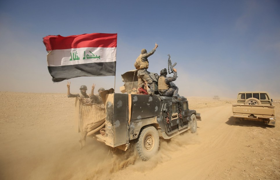 """TOPSHOT - Iraqi forces deploy in the Bajwaniyah village, about 30 kms south of Mosul, on October 18, 2016 after they liberated it from Islamic State (IS) group jihadists. Tens of thousands of Iraqi forces were making gains on the Islamic State group in Mosul in an offensive US President Barack Obama warned would be a """"difficult fight"""". / AFP PHOTO / AHMAD AL-RUBAYEAHMAD AL-RUBAYE/AFP/Getty Images"""