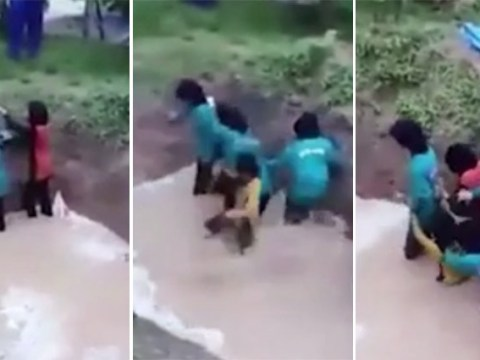 Children filmed screaming after being forced into snake pit during 'confidence building exercise'