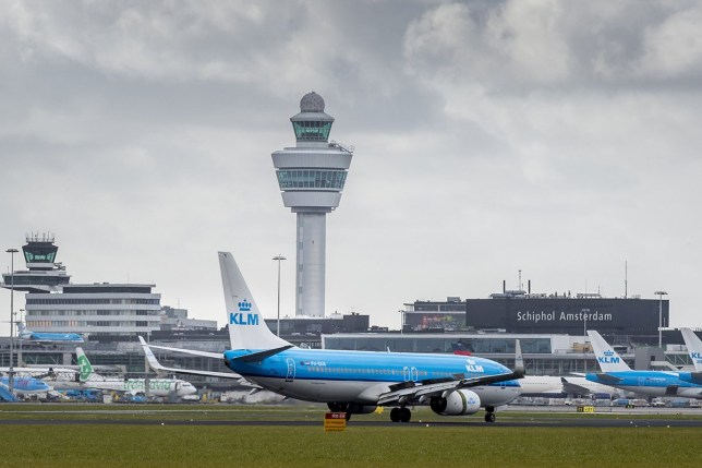 A picture taken on March 2, 2016 shows KLM Royal Dutch Airlines planes close to the control tower at Schiphol Airport in Amsterdam. nThe Dutch Safety Board (DSB/OVV) starts a big investigation on the safety around air traffic at and around the airport. / AFP / ANP / Lex van Lieshout / Netherlands OUT (Photo credit should read LEX VAN LIESHOUT/AFP/Getty Images)