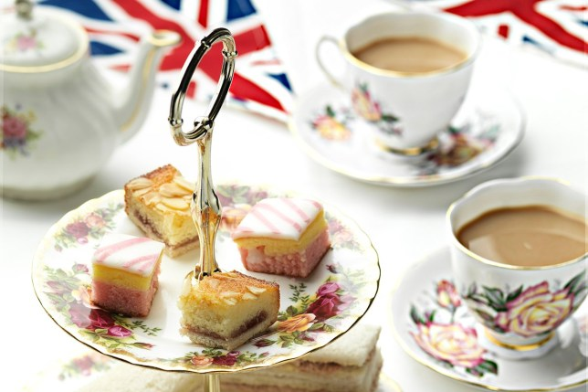 credit: TS Photography/Getty. Traditional British afternoon tea with teapot, cakes, sandwiches and Union Jack bunting.