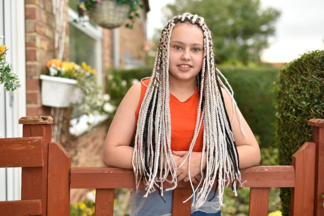 """Chenise Benson 14 with her new dreadlocks. See Ross Parry story RPYHAIR. A dad is fuming after his daughter was sent home from school for having this incredible haircut - of long bright white DREADLOCKS. Angry Darren Benson, 39, has given teachers at George Pindar School the hairdryer treatment after 13-year-old Chanise Benson caused a stir with her hairdo. He splashed out £140 for her to have the style - which looks like the henchman twins from The Matrix sequels. Chanise had the style done for her sister's birthday during the half term break - but was sent home from school when she went back. But Darren has accused the school of """"double standards""""- because a friend of hers of Jamaican-descent is allowed dreads."""