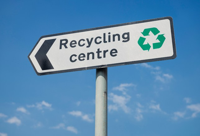 pic - getty A sign for a public recycling centre, with a green recycling symbol.