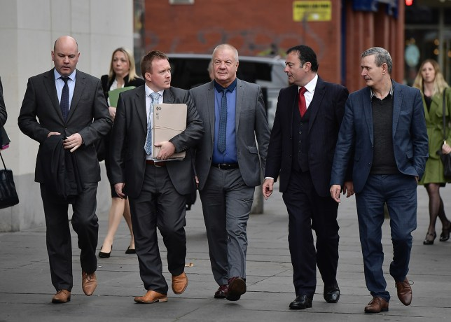 BELFAST, NORTHERN IRELAND - OCTOBER 04: Raymond McCord (C) arrives with his legal team at Belfast High Court to launch a landmark legal bid to stop the UK's planned departure from the European Union on October 4, 2016 in Belfast, Northern Ireland. Mr Justice Maguire has aside two days for the legal challenges to Brexit. He is to focus on all issues and implications specific to Northern Ireland including claims that leaving the EU will inflict damage on the peace process. Raymond McCord, with backing from local politicians including Alliance party MLA David Ford, SDLP leader Colum Eastwood, Sinn Fein MLA John O'Dowd and Steven Agnew of the Green Party is seeking to judicially review the British Government's move towards leaving the EU. Mr McCord's legal team contend Brexit will undermine the UK's domestic and international treaty obligations under the Good Friday peace accord. (Photo by Charles McQuillan/Getty Images)