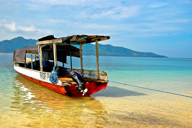 A boat on a beach in Indonesia