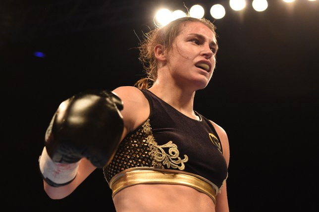 LONDON, ENGLAND - NOVEMBER 26: Katie Taylor of Ireland lands a right hand punch on Karina Kopinska during a lightweight contest at Wembley Arena on November 26, 2016 in London, England. (Photo by Leigh Dawney/Getty Images)