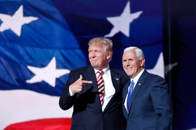 Republican presidential Candidate Donald Trump, points toward Republican Vice presidential candidate Gov. Mike Pence of Indiana after Pence's acceptance speech during the third day session of the Republican National Convention in Cleveland, Wednesday, July 20, 2016. (AP Photo/Mary Altaffer)