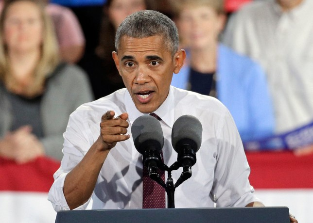 President Barack Obama speaks during a campaign rally for Democratic presidential candidate Hillary Clinton in Charlotte, N.C., Friday, Nov. 4, 2016. (AP Photo/Chuck Burton)