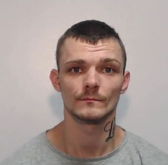 Police mugshot of Scott Hughes who has been jaled for stabbing his partner