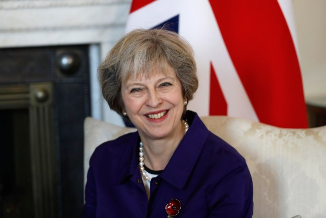 LONDON, UNITED KINGDOM - NOVEMBER 02: Prime Minister Theresa May smiles during a bilateral meeting with Colombia's President Juan Manuel Santos (not seen) at 10 Downing Street  at Buckingham Palace on November 2, 2016 in London, England. The President of the Republic of Colombia Juan Manuel Santos and his wife Maria Clemencia Rodriguez de Santos are paying their first State Visit to the UK as official guests of Queen Elizabeth.  (Photo by Kirsty Wigglesworth - WPA Pool/Getty Images)