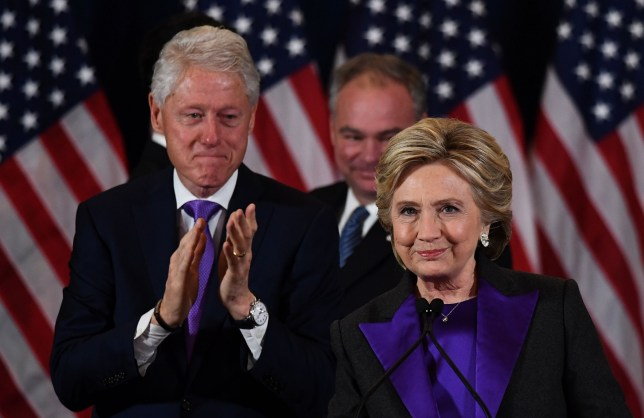 TOPSHOT - US Democratic presidential candidate Hillary Clinton makes a concession speech after being defeated by Republican president-elect Donald Trump as former President Bill Clinton(L) and running mate Tim Kaine look on in New York on November 9, 2016. / AFP PHOTO / JEWEL SAMADJEWEL SAMAD/AFP/Getty Images