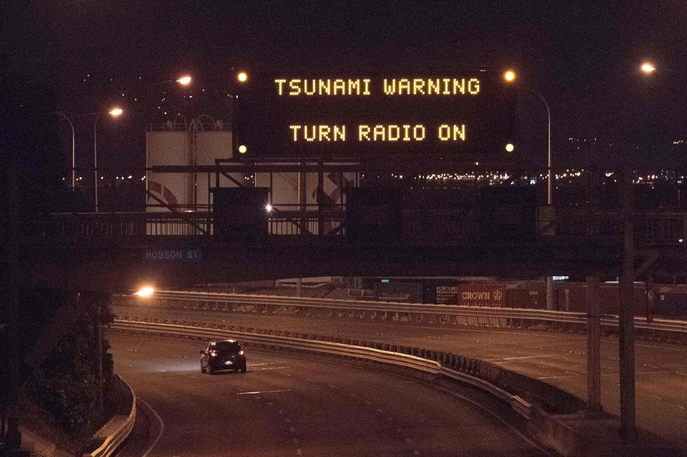 A tsunami warning alert is seen on a notice board above State Highway 1 in Wellington early on November 14, 2016 following an earthquake centred some 90 kilometres (57 miles) north of New Zealand's South Island city of Christchurch. A powerful 7.8 magnitude earthquake rocked New Zealand early November 14, the US Geological Survey said, prompting a tsunami warning and knocking out power and phone services in many parts of the country. / AFP PHOTO / Marty MelvilleMARTY MELVILLE/AFP/Getty Images