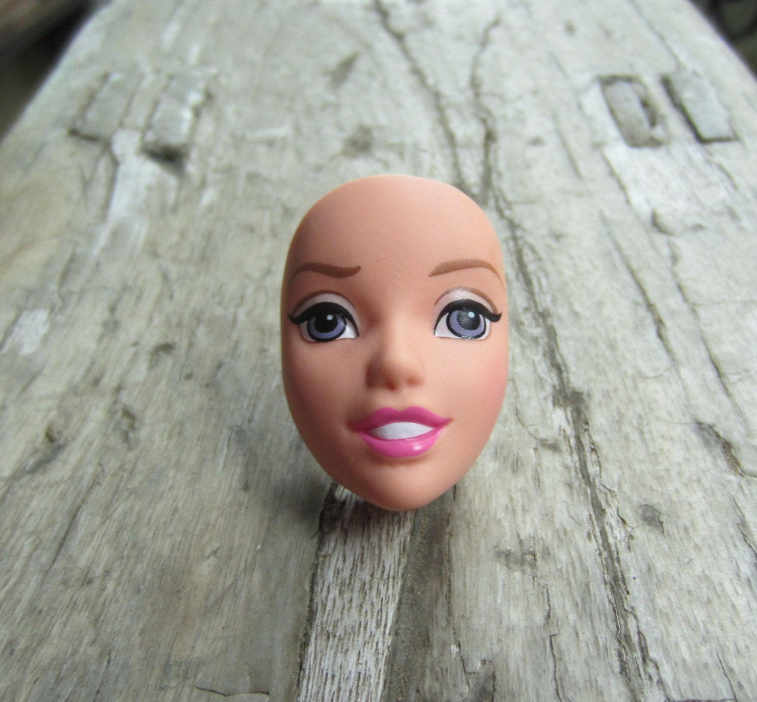 The new big trend is wearing Barbie's decapitated head on your fingers Credit: Etsy