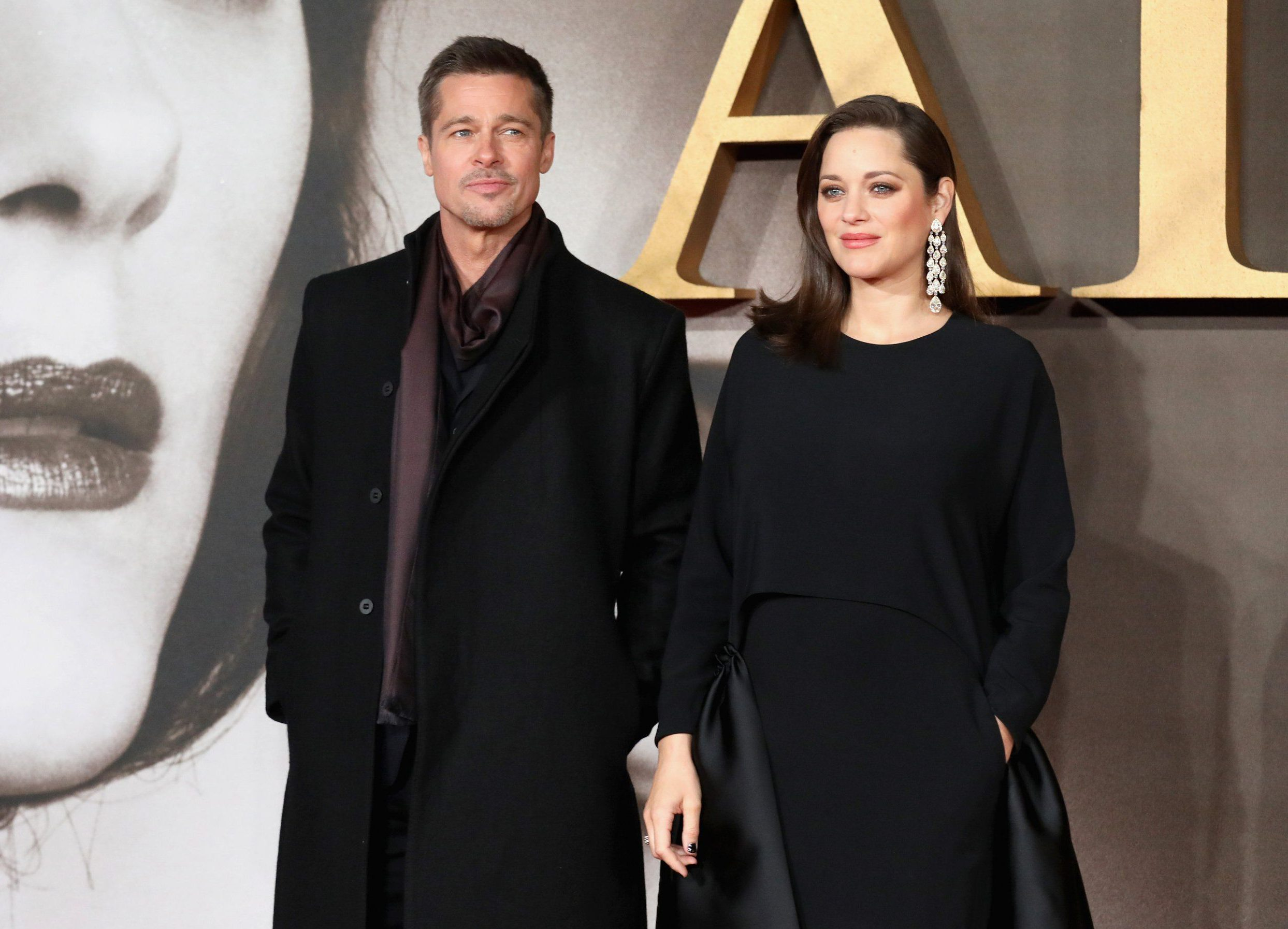 """LONDON, ENGLAND - NOVEMBER 21: Brad Pitt and Marion Cotillard attend the UK Premiere of """"Allied"""" at Odeon Leicester Square on November 21, 2016 in London, England. (Photo by Tim P. Whitby/Getty Images)"""
