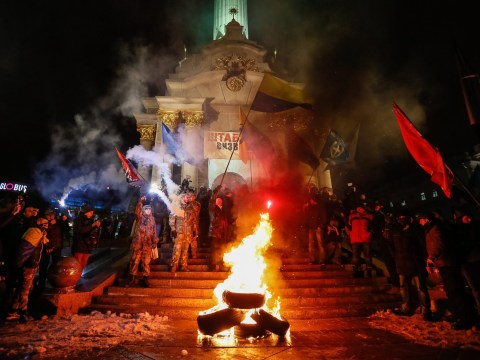 Thousands take to streets of Kiev as commemorative rally turns violent