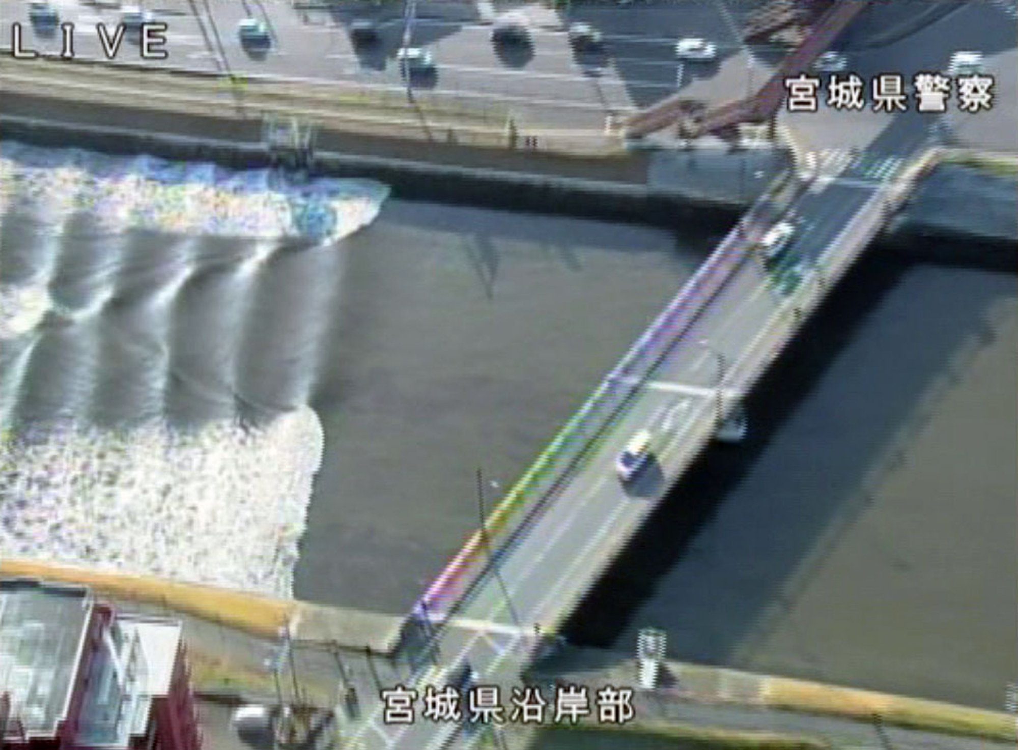 In this image made from video released by Miyagi Prefectural Police, the water flows up river in the Sunaoshi River in Tagajo, Miyagi prefecture, northern Japan, as a tsunami warning is issued following a strong earthquake Tuesday, Nov. 22, 2016. A powerful earthquake off the northeast Japanese shore Tuesday sent residents fleeing to higher ground and prompted worries about the Fukushima nuclear power plant destroyed by a tsunami five year ago. The warning was lifted nearly four hours later. (Miyagi Prefectural Police/Kyodo News via AP)