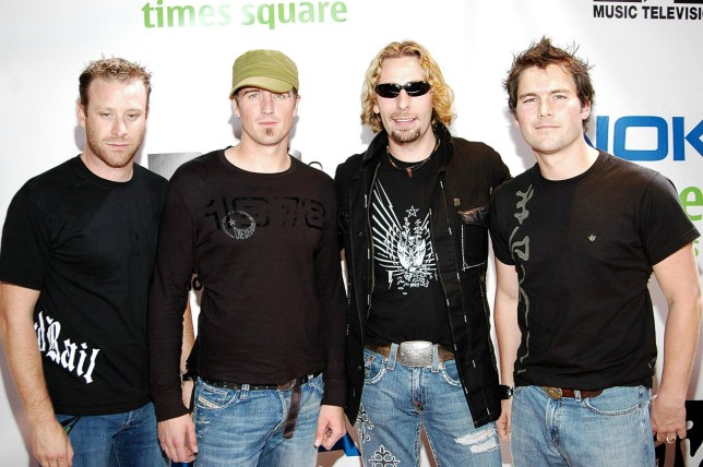 Nickelback, Mike Kroeger, Daniel Adair, Chad Kroeger, Ryan Peake on location for MTV and NOKIA UNWIRED Live Concert Event, Nokia Theatre Times Square, New York, September 27, 2005; Shutterstock ID 166144217