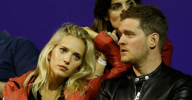 BUENOS AIRES, ARGENTINA - FEBRUARY 27: Singer Michael Buble (R) and his wife Luisana Lopilato (L) look the singles match between Rafael Nadal of Spain and Federico Delbonis of Argentina as part of ATP Argentina Open at Buenos Aires Lawn Tennis Club on February 27, 2015 in Buenos Aires, Argentina. (Photo by Gabriel Rossi/LatinContent/Getty Images)