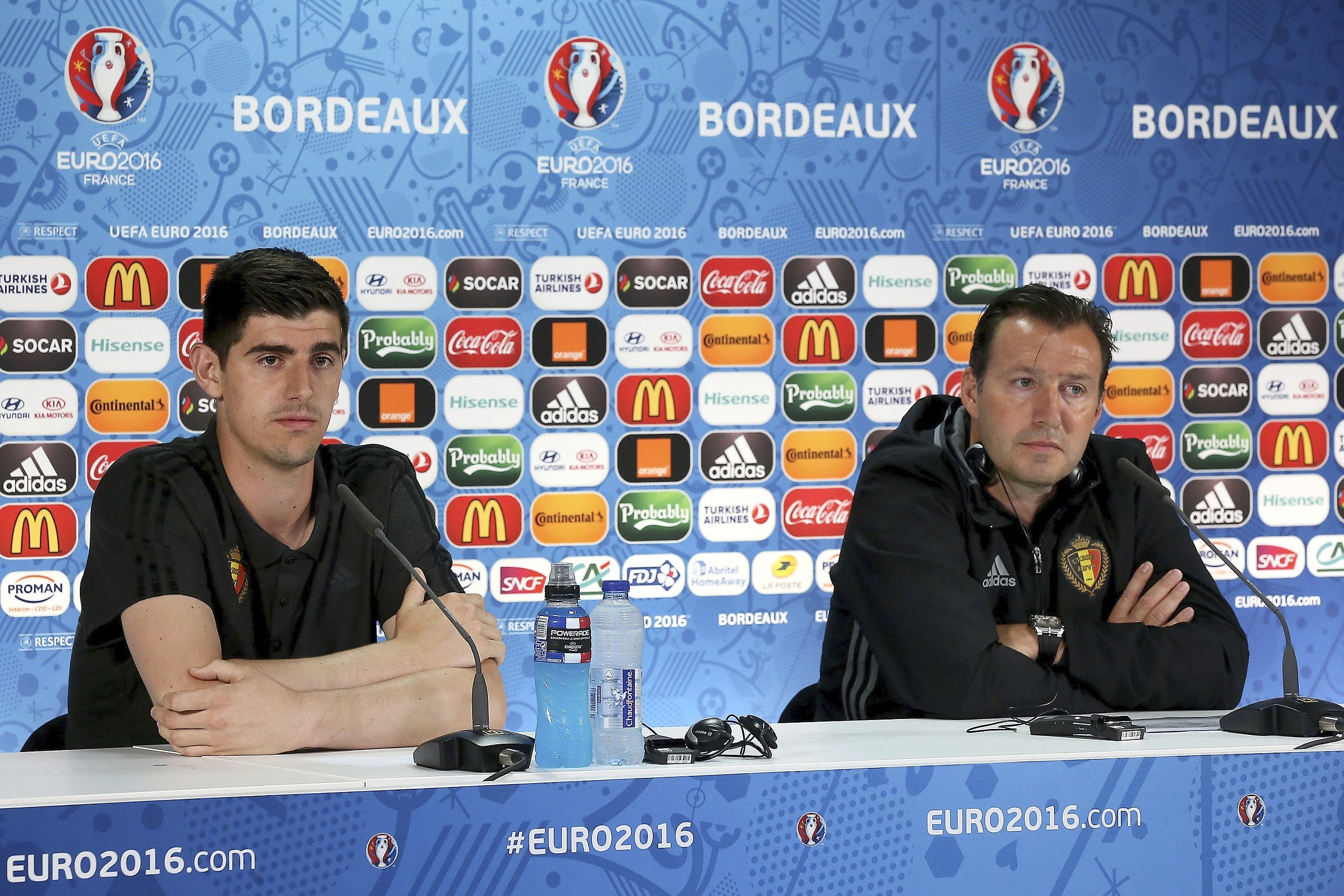 BORDEAUX, FRANCE - JUNE 17 : Courtois Thibaut goalkeeper of Belgium and Wilmots Marc head coach of Belgian Team talking to the press during a press conference before a training session of the National Soccer Team of Belgium prior to the UEFA EURO 2016 phase final group E match between Belgium and Republic of Ireland at the Stade de Bordeaux on June 17, 2016 in Bordeaux, France , 17/06/2016 ( Photo by UEFA (Handout photo provided by UEFA / Photonews via Getty Images)