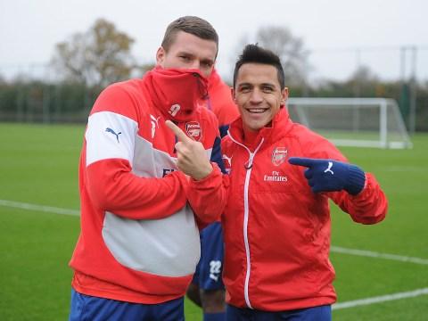 Arsenal cult hero Lukas Podolski congratulates Alexis Sanchez after hat trick v West Ham