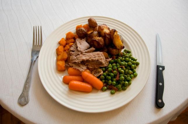 Christmas dinner roast lamb, sweet potato, roast potatos, peas with bacon and carrots
