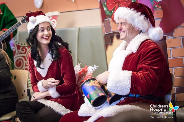 Undated handout photo issued courtesy Children's Hospital Los Angeles of Katy Perry and Orlando Bloom who brought some Christmas cheer to poorly children in the Children's Hospital Los Angeles during the festive period. PRESS ASSOCIATION Photo. Issue date: Wednesday December 21, 2016. The famous duo, who are reportedly dating, dressed up as Santa and Mrs Claus as they visited youngsters at the Children's Hospital. See PA story SHOWBIZ Perry. Photo credit should read: Children's Hospital Los Angeles/PA Wire NOTE TO EDITORS: This handout photo may only be used in for editorial reporting purposes for the contemporaneous illustration of events, things or the people in the image or facts mentioned in the caption. Reuse of the picture may require further permission from the copyright holder.
