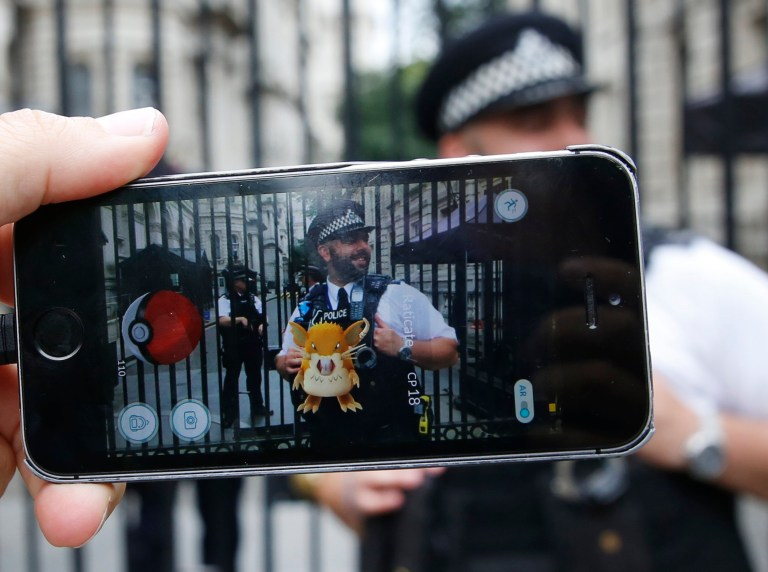 LONDON, ENGLAND - JULY 15: A Raticate, a character from Pokemon Go, a mobile game that has become a global phenomenon, on July 15, 2016, in front of the gates of Downing St , London, England. The app lets players roam using their phone's GPS location data and catch Pokemon to train and battle.The game has added millions to the value of Nintendo, which part-owns the franchise. (Photo by Olivia Harris/Getty Images)