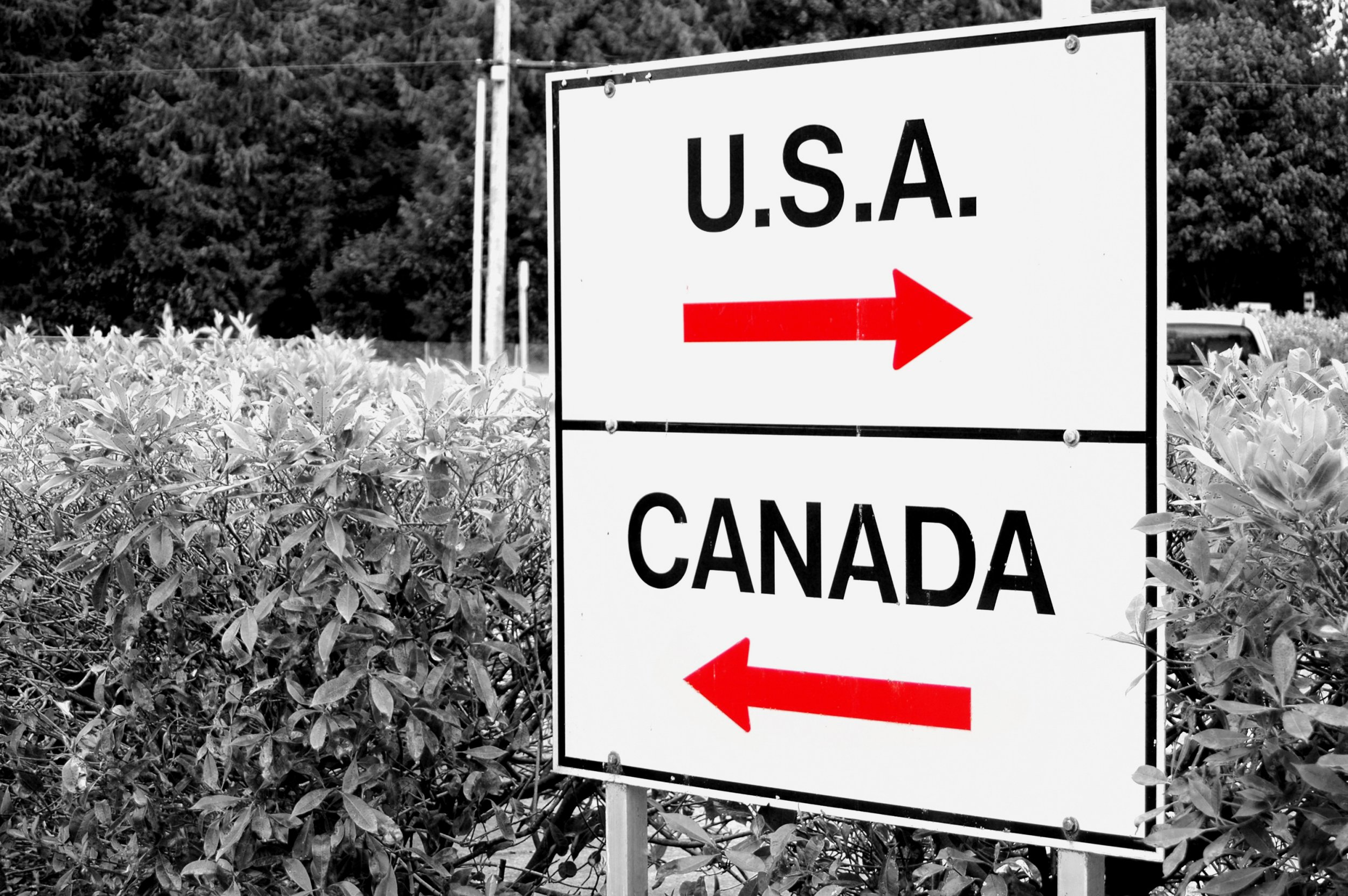 A shot of a sign at the US/Canadian border