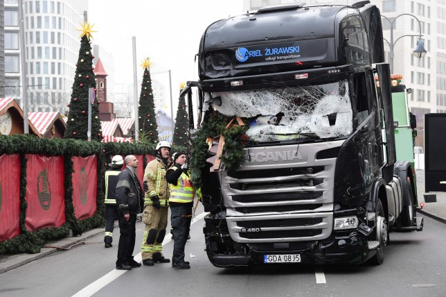 "View of the truck that crashed the evening before into a christmas market at Ged¿chtniskirche church on early December 20, 2016 in Berlin. German police said December 20, 2016 they were treating as ""a probable terrorist attack"" the killing of 12 people when a lorry ploughed through a packed Berlin Christmas market. / AFP PHOTO / Tobias SCHWARZTOBIAS SCHWARZ/AFP/Getty Images"