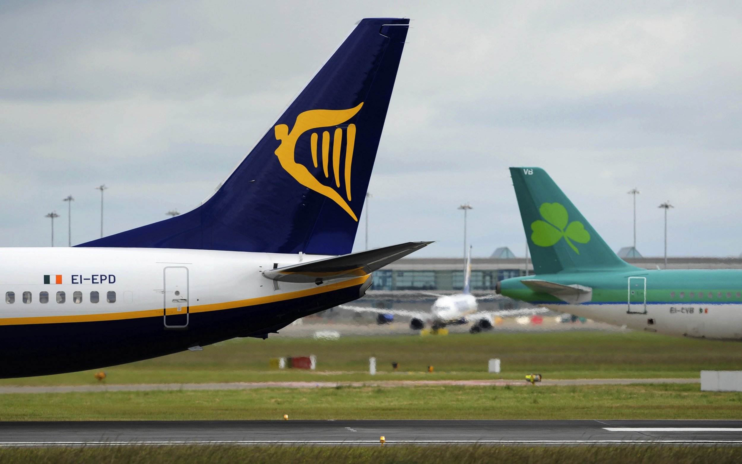Ryanair and Aer Lingus ordered to pay £13.5 MILLION tax bill A Boeing 737 aircraft, left, operated by Ryanair Holdings Plc, taxis past an Airbus SAS A320, operated by Aer Lingus Group Plc, at Dublin Airport in Dublin, Ireland, on Thursday, June 9, 2011. Aer Lingus Group Plc's total booked passenger numbers rose 4 percent to 911,000 in May from the year earlier. Photographer: Aidan Crawley/Bloomberg via Getty Images