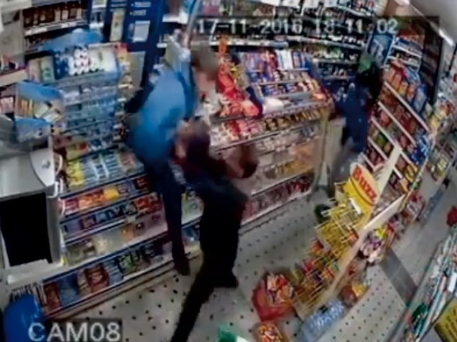 CCTV grab of the moment a 12-year-old schoolboy is pulled down from the shop counter by shop keeper after taking cigarettes. See National News story NNROB; He stole cigarettes and alcohol when he ransacked a corner shop with a gang of three friends. During a raid at Londis in Dagenham, east London, the young thug leapt over the counter to grab cigarettes before he punched the shopkeeper while other kids hit him with a bottle and threw a shop sign at him. Inside the store on November 17, the gang stole a drink from the fridge and grabbed bags of sweets but as the shopkeeper tried to throw the kids out they beat him up and left him lying helpless on the pavement. Less than a month earlier on October 23 the gang had targeted another convenience store, A1 Cash and Carry, nearby.
