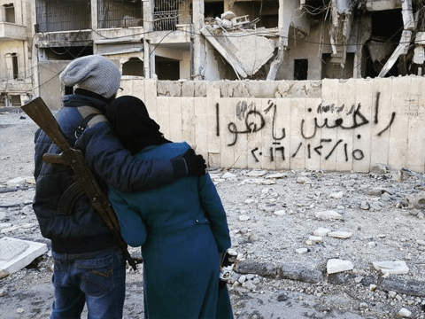 Graffiti left behind by fleeing Syrians vowing to 'come back home'