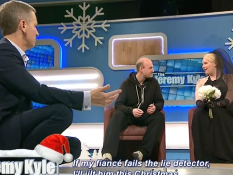 Frustrated Jeremy Kyle decides to climb up his Christmas tree as warring couple keep talking over him
