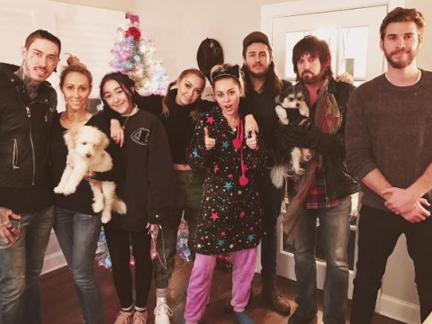 Liam Hemsworth joins Miley Cyrus and her family for an uncomfortable Christmas photo