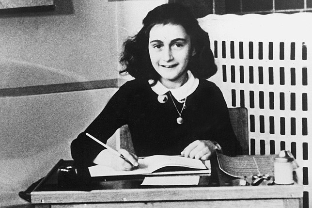 Anne Frank might not have been betrayed credit rex No Merchandising. Editorial Use Only. No Book Cover Usage Mandatory Credit: Photo by Everett/REX/Shutterstock (419592a) Anne Frank Writing in Her Diary ANNE FRANK
