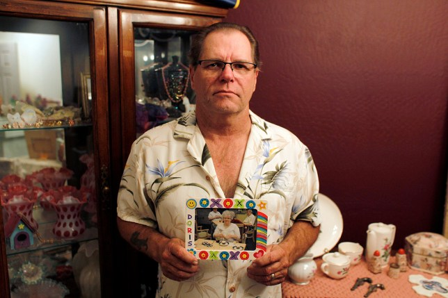 US military blowing up bodies donated for medical research Jim Stauffer holds a photo of his late mother Doris Stauffer while posing for a photo in his home in Surprise, Arizona, U.S. December 21, 2016.    To match Special Report USA-BODYBROKERS/INDUSTRY     REUTERS/Ricardo Arduengo - RTX2WAYE