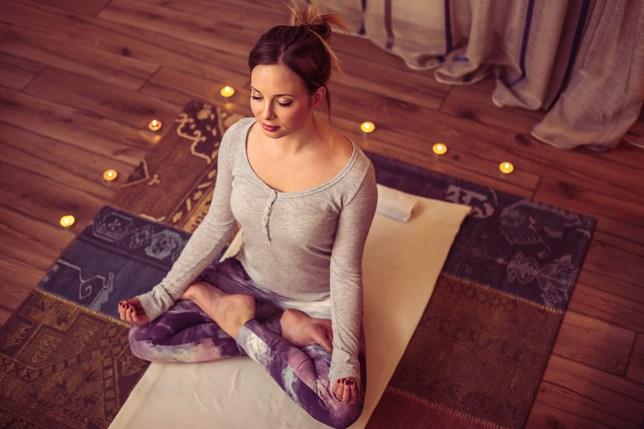 Woman doing yoga exercise; Shutterstock ID 422910811