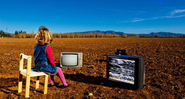 Girl watching different tv outdoors