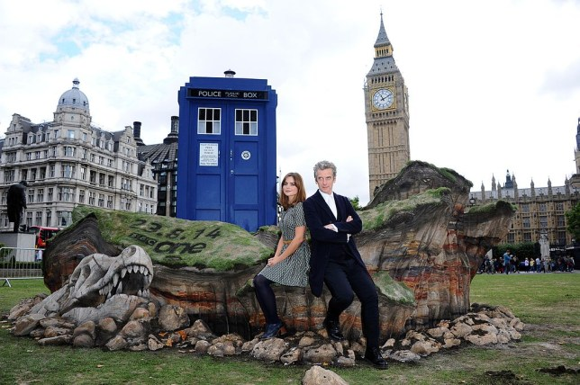"LONDON, ENGLAND - AUGUST 22: Peter Capaldi and Jenna Coleman attend a photocall ahead of the new BBC series of ""Dr Who"" in Parliament Square on August 22, 2014 in London, England. (Photo by Stuart C. Wilson/Getty Images)"