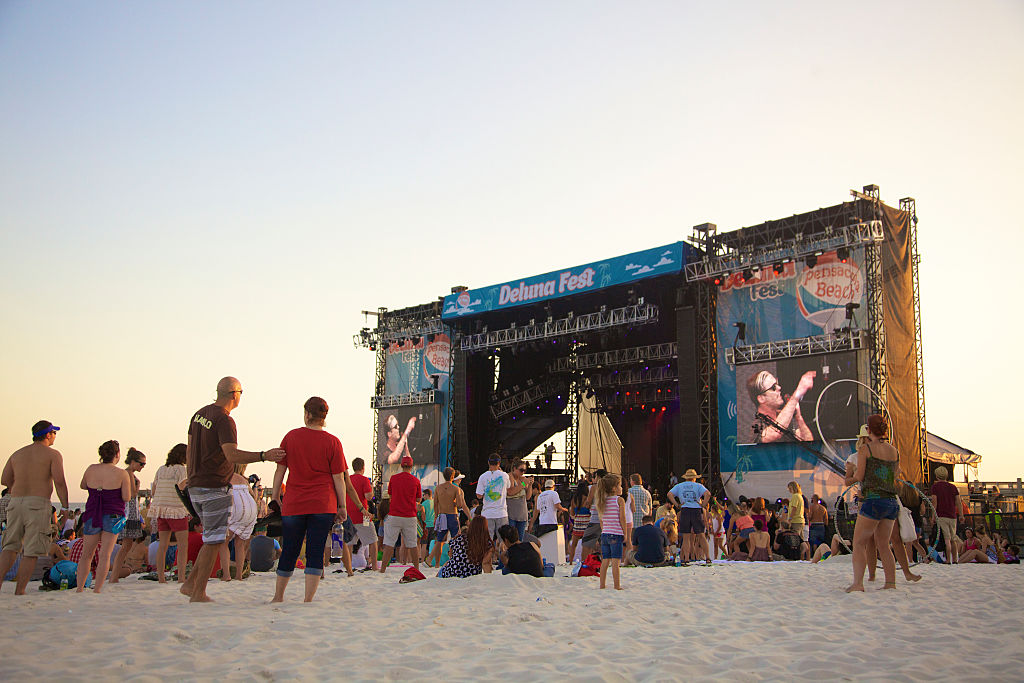 Concert attendees enjoy the surf, sand, sun and bands at Deluna Fest in Pensacola, Florida