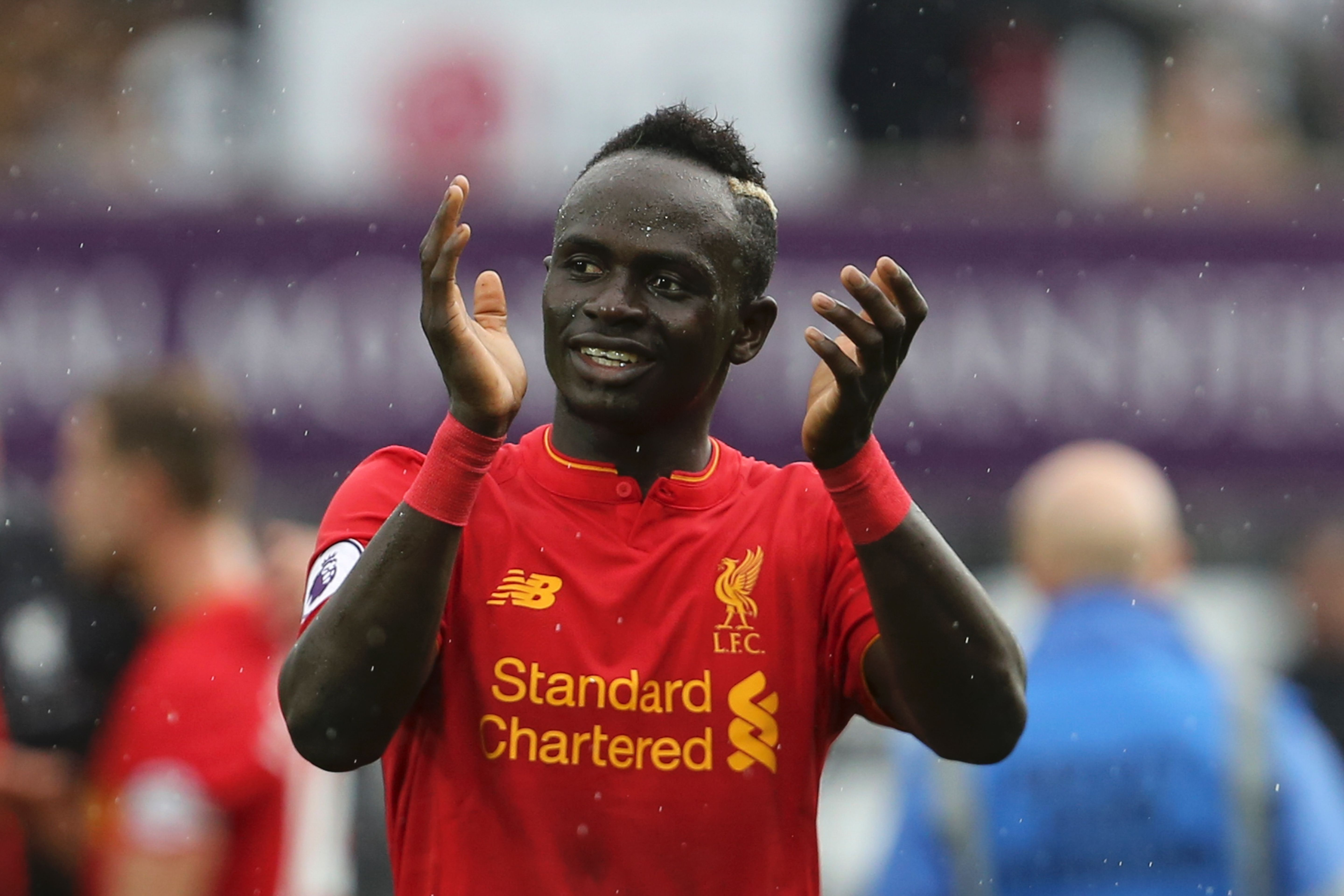 Liverpool's Senegalese midfielder Sadio Mane applauds at the end of the English Premier League football match between Swansea City and Liverpool at The Liberty Stadium in Swansea, south Wales on October 1, 2016. / AFP / GEOFF CADDICK / RESTRICTED TO EDITORIAL USE. No use with unauthorized audio, video, data, fixture lists, club/league logos or 'live' services. Online in-match use limited to 75 images, no video emulation. No use in betting, games or single club/league/player publications.  /         (Photo credit should read GEOFF CADDICK/AFP/Getty Images)