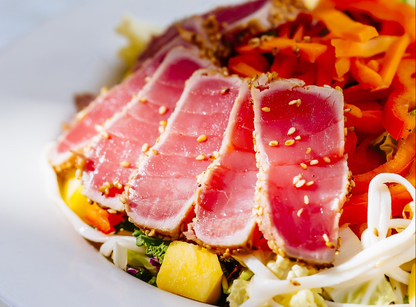 Plate of sliced tuna and salad