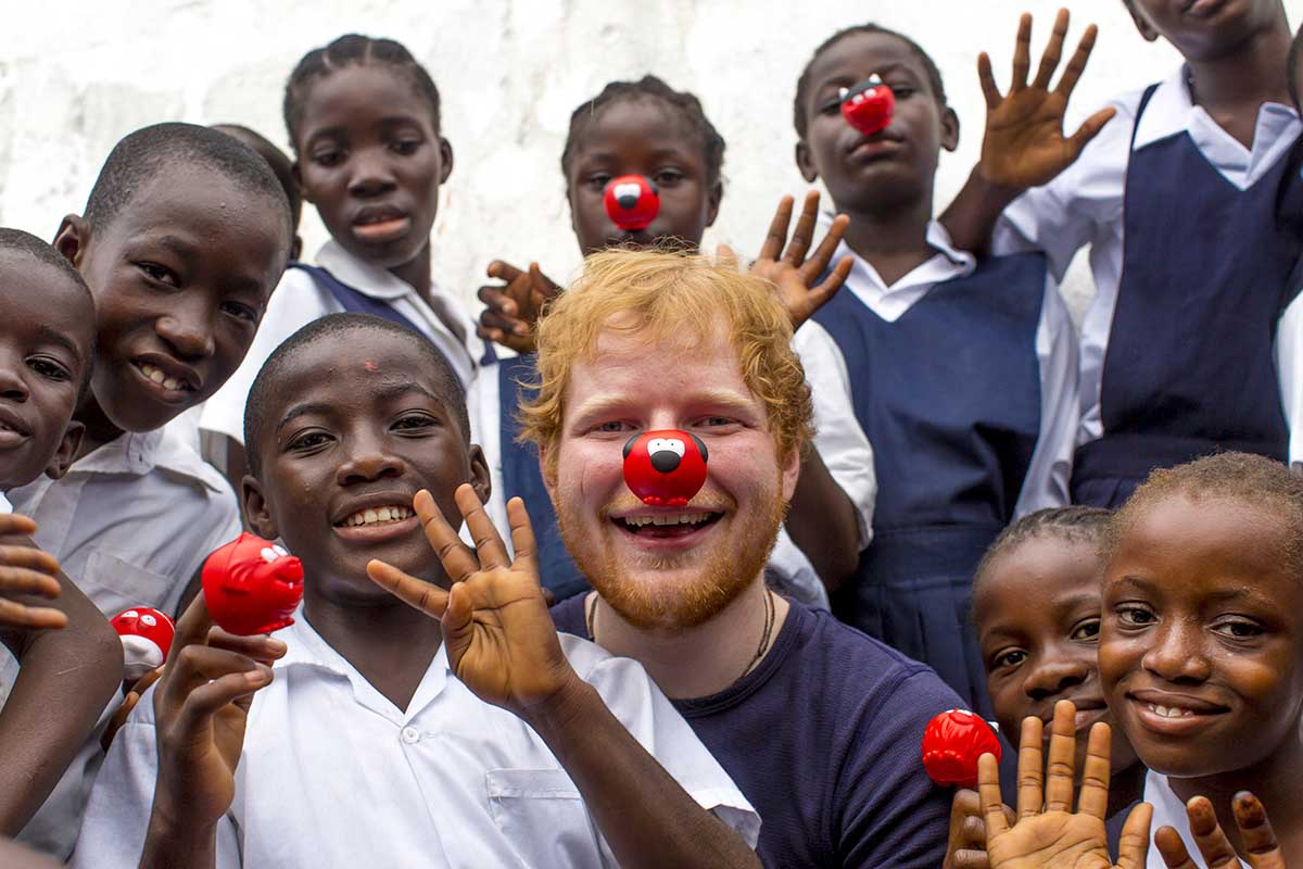 Embargoed to 0001 Tuesday January 31 Undated handout photo issued by Comic Relief of Ed Sheeran who visited the Street Child Liberia project in Liberia, which uses Comic Relief money to help give vulnerable children a safe place to stay, reuniting them with their relatives and helping them get back into school, ahead of Red Nose Day on March 24. PRESS ASSOCIATION Photo. Issue date: Tuesday January 31, 2017. See PA story SHOWBIZ Red. Photo credit should read: Freddie Claire/Comic Relief/PA Wire NOTE TO EDITORS: This handout photo may only be used in for editorial reporting purposes for the contemporaneous illustration of events, things or the people in the image or facts mentioned in the caption. Reuse of the picture may require further permission from the copyright holder.