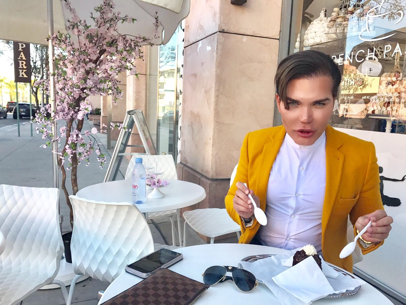 "Human Ken doll Rodrigo Alves pictured piling on the pounds so he can have his own fat surgically removed and used as a bottom filler. See SWNS story SWKEN; A human Ken doll and plastic surgery addict has GAINED two stones to have liposuction - so surgeons can pump the fat back into his BUM. Rodrigo Alves, 33, has already spent £360,000 on dozens of body-changing operations - including liposuction, six-pack implants and botox fillers. But the former air steward has spent the last few months eating cakes and puddings to pile on the pounds, gorging on more than 3,000 calories a day. He has gained two stones so he can have the fat transferred from his back, waist, and thighs and into his lower legs and bum to make them more ""contoured""."