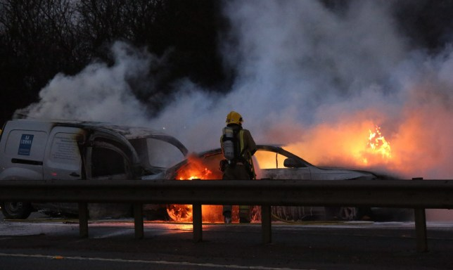 Lemington, Warwickshire Monday 9th January 2016. M40 Southbound is closed following two vehicles crashing into each other and bursting into a fireball. There is a 30 mile tail back as a result of the crash. Flames shot 30 feet in the air during the rush hour crash and nearly catch tree on fire at the near by services©UKNIP