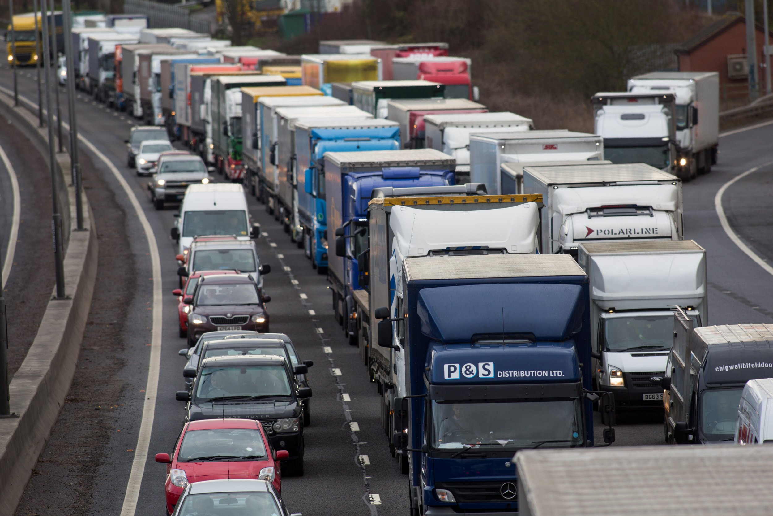 Lorries and cars caught in heavy traffic northbound at the junction 16 turn off on the M1. The M1 has been closed from junctions 16-18 following a body being found at roughly 3am. January 10, 2017.  A body has been found in the middle of a motorway, sparking an intense police investigation.  See NTI story NTIBODY.  Northamptonshire Police have now closed off a stretch of the M1 after finding the body on the motorway overnight.  A police spokesperson said the M1ís closure came ìfollowing the discovery of a body in roadî.  The motorwayís northbound carriageway was closed at about 3am, Tuesday, January 10, from junctions 16 to 17.