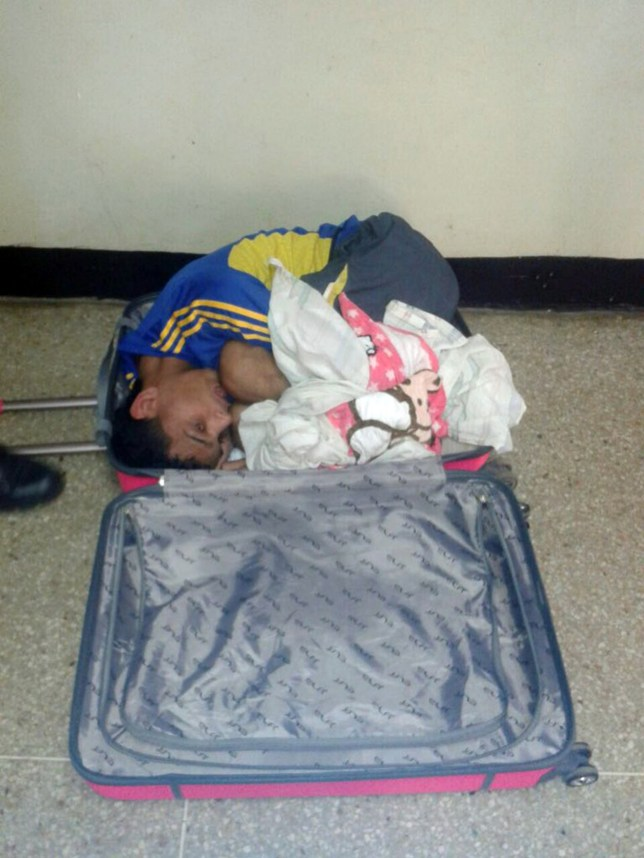 Pic shows: man hidden inside the luggage.nnA woman tried to smuggle her boyfriend out of prison by hiding him in a pink suitcase but got caught when she struggled to pull it along on her way out.nnThe attempted jailbreak took place in the Jose Antonio Anzoategui prison, better known as Puente Ayala, located in the state of Anzoategui, in north-eastern Venezuela.nnAntonieta Robles Saouda, 25, went to the jail with a six-year-old girl to visit Ibrain Jose Vargas Garcia, who is serving nine years and eight months after being convicted for car robbery.nnShe came in carrying a pink suitcase but the guards¿ suspicions were aroused when she had difficulty moving it on the way out.nnOn closer inspection, they found Vargas huddled inside.nnThough a small and slim man, Vargas has evidently performed a feat of contortionism to cram himself into the small space, as pictures released by the jail show.nnThe brand-new looking pink suitcase is large but no larger than those usually seen at airports, and Saouda had even crammed in some extra material, perhaps to soften the outline of Vargas¿s form.nnAnother photo shows a handcuffed and glum-looking Vargas after he was pulled out of the suitcase.nnThe couple were both arrested and the man was sent back to his cell. The little girl was put in the temporary care of Social Services.nn(ends)n Credit: CEN