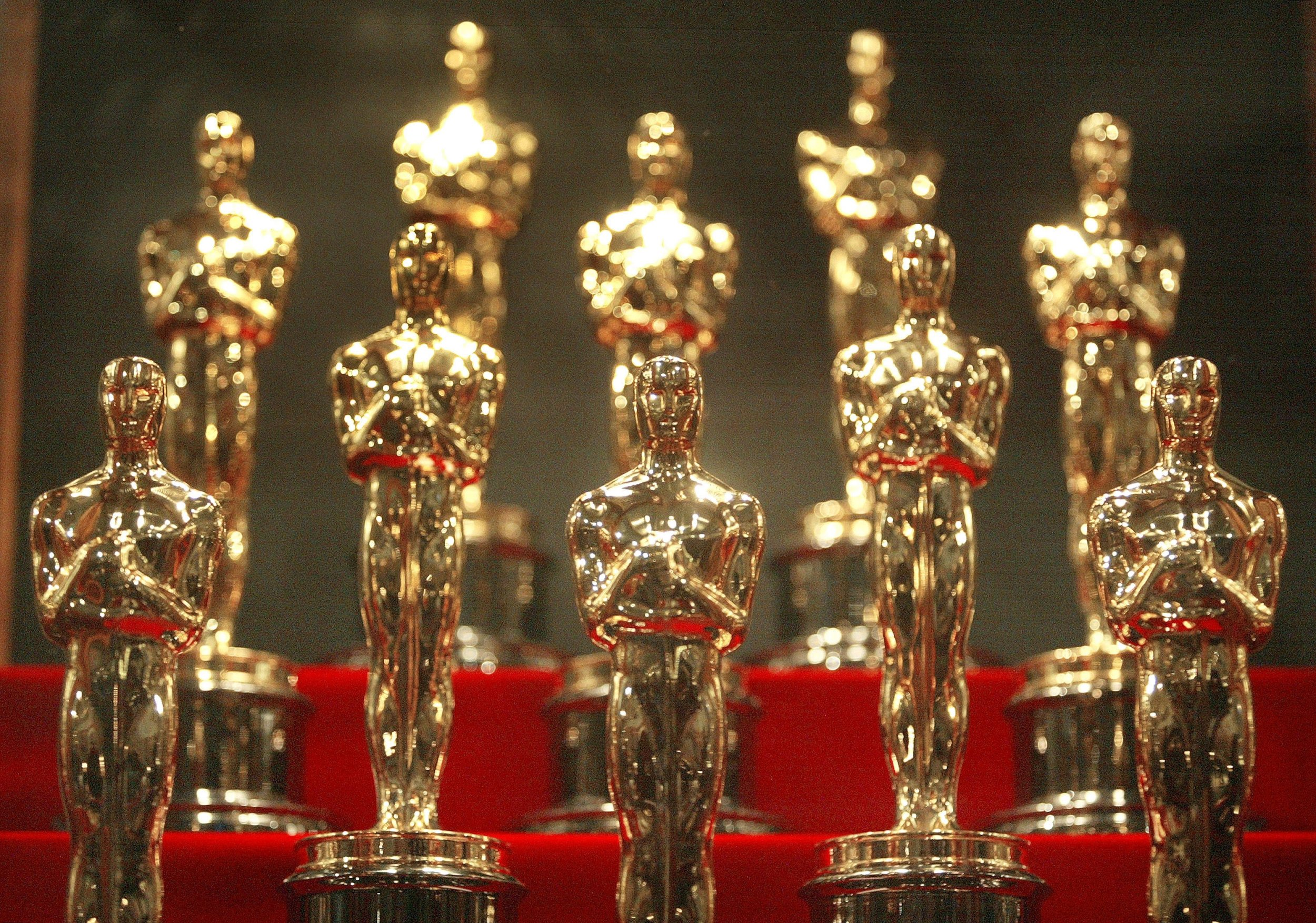 oscars (Getty) CHICAGO - JANUARY 23: Oscar statuettes are displayed during an unveiling of the 50 Oscar statuettes to be awarded at the 76th Academy Awards ceremony January 23, 2004 at the Museum of Science and Industry in Chicago, Illinois. The statuettes are made in Chicago by R.S. Owens and Company. (Photo by Tim Boyle/Getty Images)