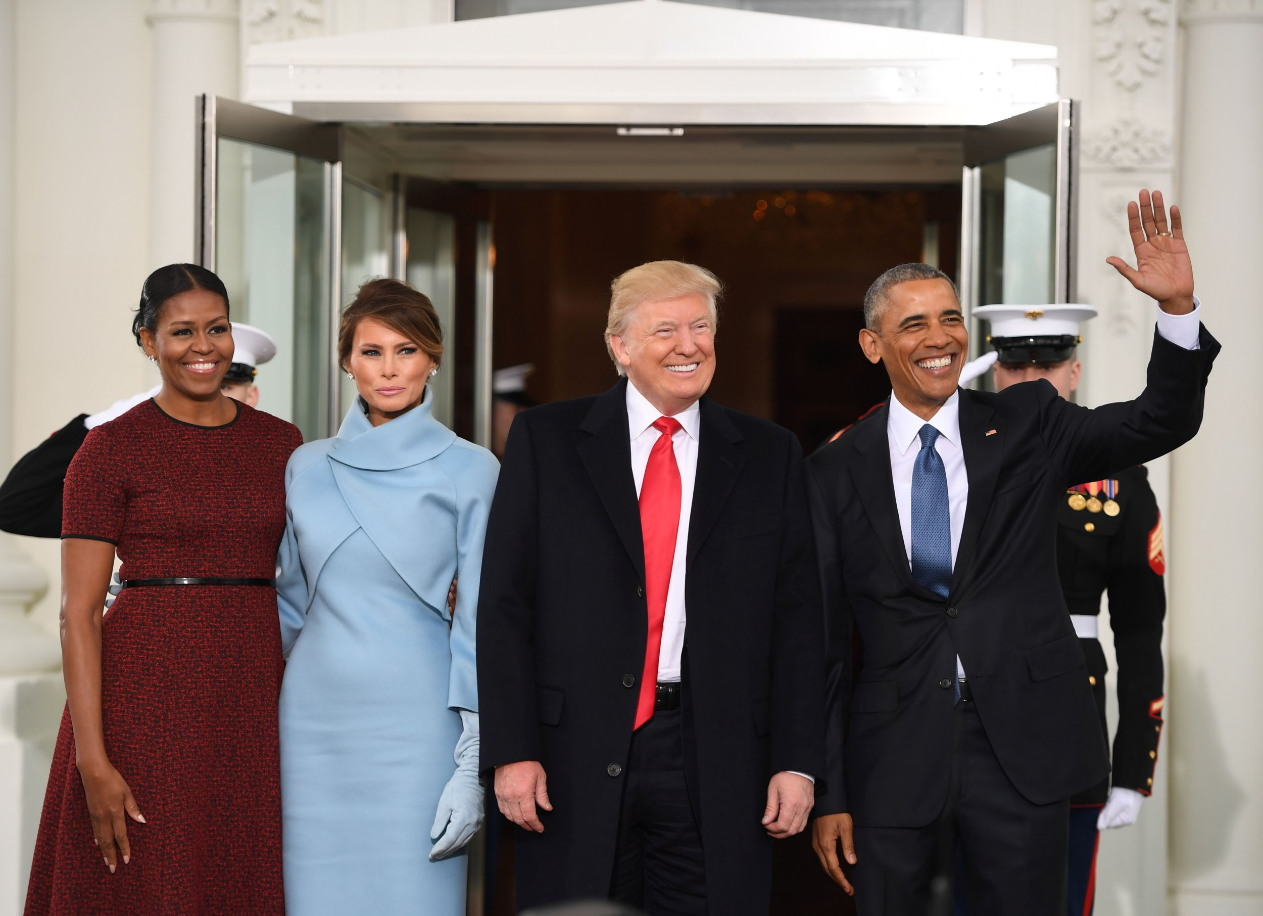 US President Barack Obama(R) and First Lady Michelle Obama(L) welcome Preisdent-elect Donald Trump(2nd-R) and his wife Melania to the White House in Washington, DC January 20, 2017. / AFP PHOTO / JIM WATSONJIM WATSON/AFP/Getty Images