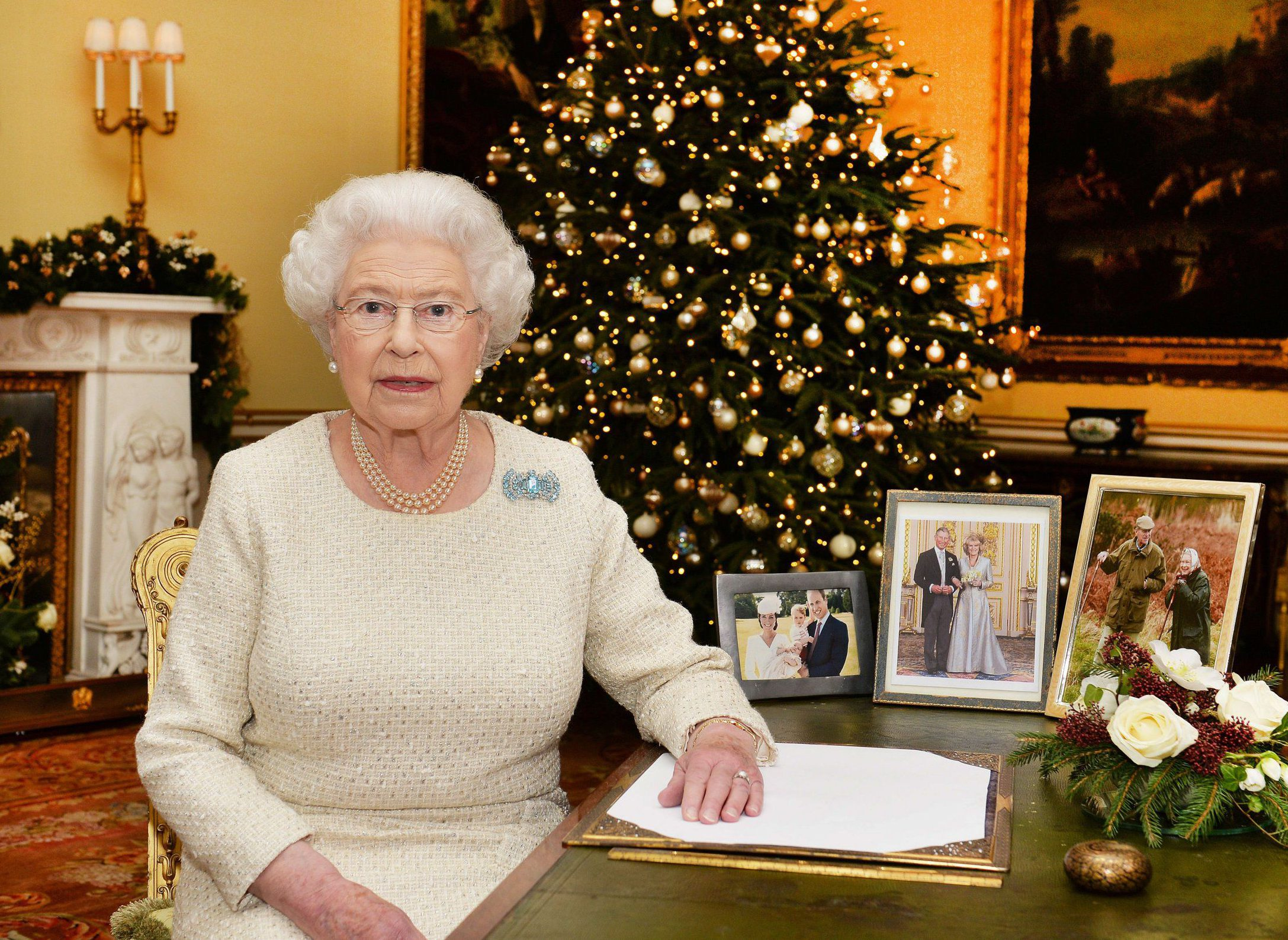 Mandatory Credit: Photo by REX/Shutterstock (5502383a)nQueen Elizabeth IInQueen Elizabeth II Christmas Broadcast, Buckingham Palace, London, Britain - 25 Dec 2015nQueen Elizabeth II sits at a desk in the 18th Century Room at Buckingham Palace, London, after recording her Christmas Day broadcast to the Commonwealthn